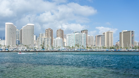Honolulu cityscape with Waikiki yacht club and seafront photo