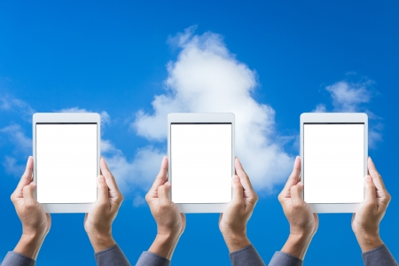 Man hand hold Tablet computer gadget with isolated on blue sky Stock Photo - 19723085