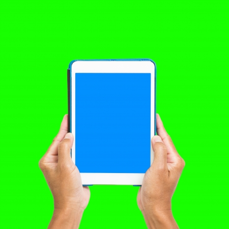 Business man show tablet with blue screen on hand, isolated on green background Stock Photo - 19722859