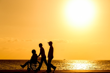 disabled in a wheel chair  Silhouettes photo