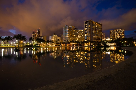 Honolulu cityscape with Waikiki yacht club and seafront at sunset photo