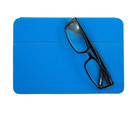 folio: Reading glasses with blue leather folio case for tablet isolated on the white