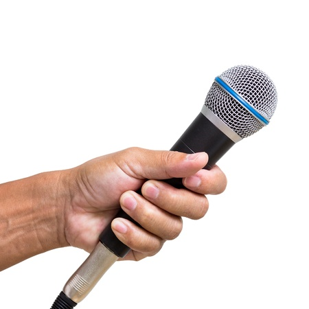 Man hand holding  microphone isolated on white background Stock Photo - 20419476