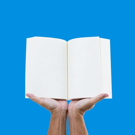 Man hand holding open book on blue screen photo