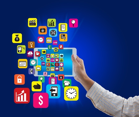 Man hand hold digital tablet with colorful application and social media icon on blue background photo