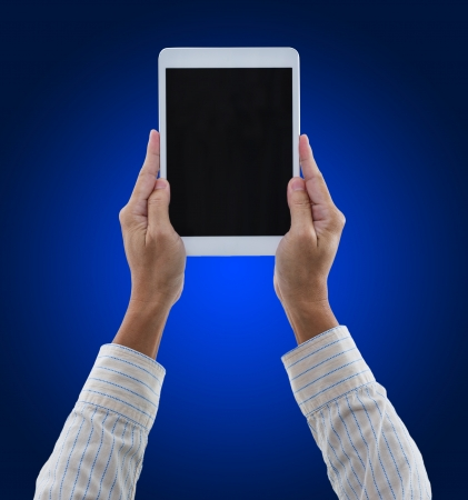 Man hands hold digital tablet isolated on blue background Stock Photo - 21685459