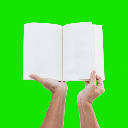 Hand holding blank notebook isolated on green background  photo