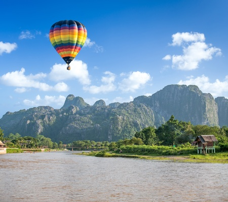 hot spring: Colorful hot air balloon over Song river Vang Vieng, Laos