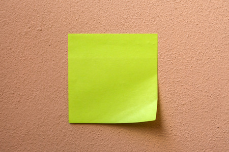 Adhesive paper note  stick on the wall photo