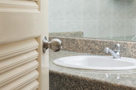 toilet door: Toilet door open with sink