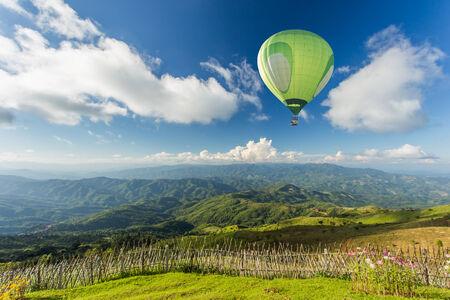 Hot air balloon over the mountain photo