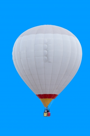 Colorful hot air balloon isolated on blue background photo