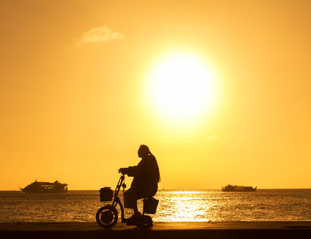 lame: disabled in a wheel chair. Silhouettes  Stock Photo