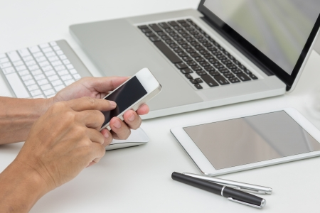 Man hand working with smartphone with computer background  Technology
