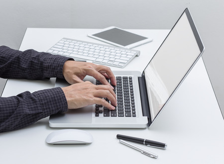 Man hands working on laptop computer Stock Photo