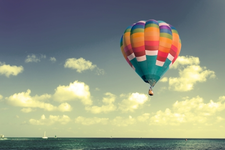 Colorful hot air balloon with retro sky photo