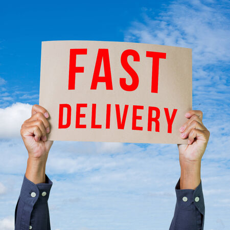 shipper: Man hand holding paper with fast delivery word Stock Photo