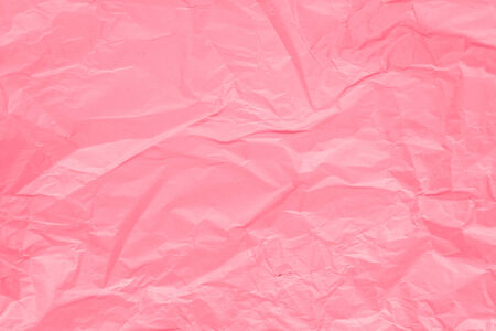 crinkled: Texture of pink crumpled paper for background