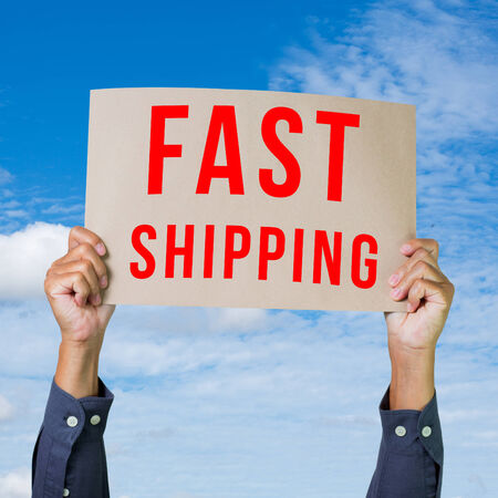 Man hand holding paper with fast shipping word photo