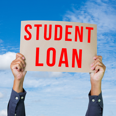 Man hand holding paper with student loan word photo