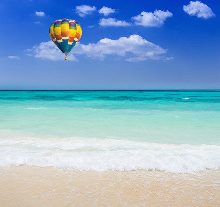 Colorful hot air balloon over the beach photo