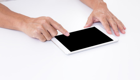 Man hand touching black screen tablet on white background photo