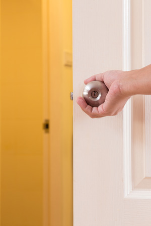Man hand open door knob photo
