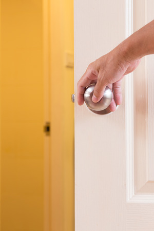 Man hand locking door knob photo