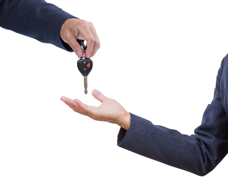Business man hand with car remote key isolated on white background photo
