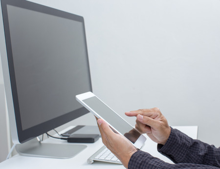 Businessman hands holding tablet computer Stock Photo