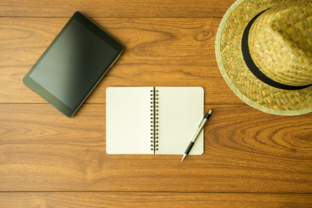 Notebook on wood background photo