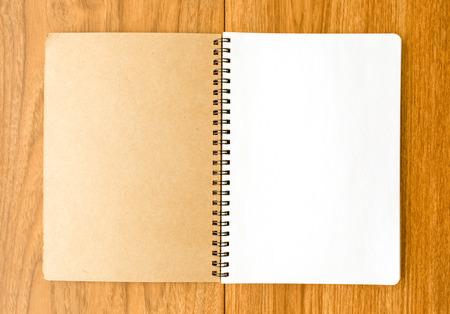 Spiral notebook on wood background