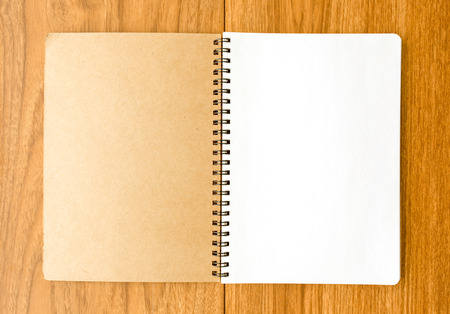 note notebook: Spiral notebook on wood background