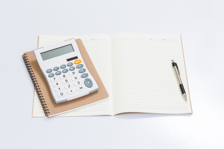 office accessories: Blank notebook with office accessories on white table Stock Photo