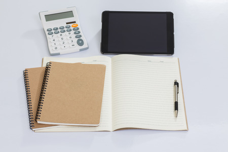 office accessories: Blank notebook and office accessories on white table Stock Photo
