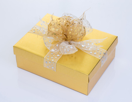 gold gift box: Gold gift box on white background