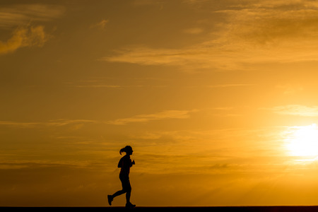 jogging track: Silhouette women jogging at sunset Stock Photo