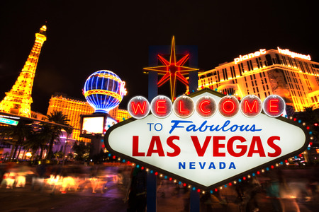 LAS VEGAS - MAY 12 : Welcome to fabulous Las Vegas neon sign with Las Vegas strip road background View of the strip on May 12, 2015 Editorial