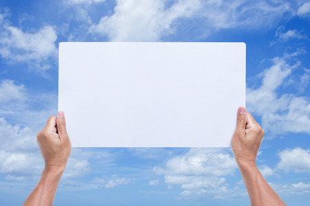 annoucement: Man hands holding blank banner with blue sky background