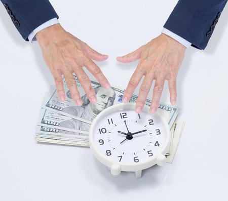 stingy: Businessman hands grabbing dollar money and clock