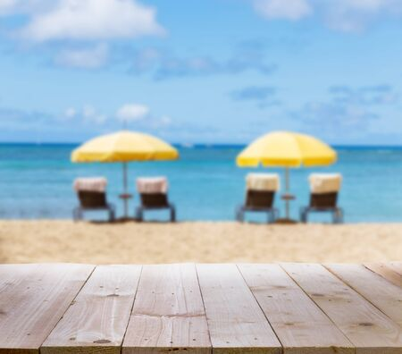 tabletop: Wood tabletop with blur beach background Stock Photo