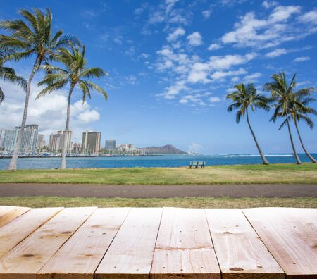 diamond head: Wood table with Diamond head mountain background, Honolulu Hawaii