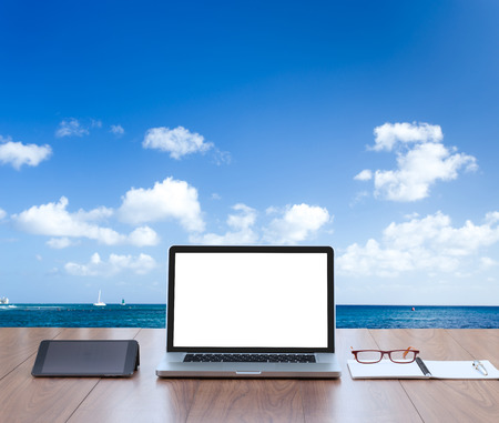 blank tablet: Blank screen laptop computer with sea background Stock Photo