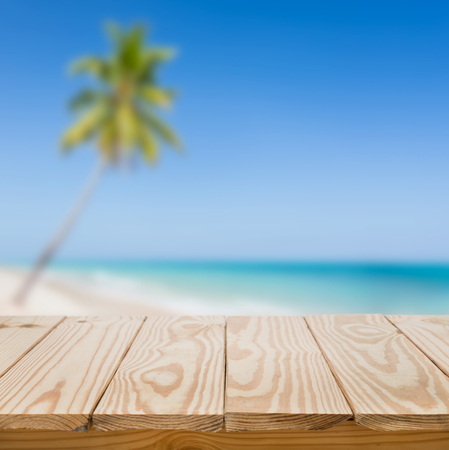 Wood table and blue sea background