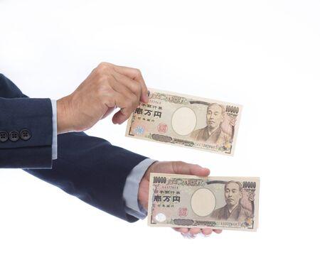 yen: Businessman hand holding Japanese Yen Stock Photo