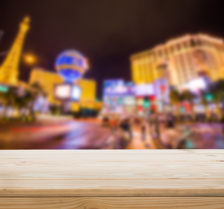 las: Wood table top with blur Las vegas background