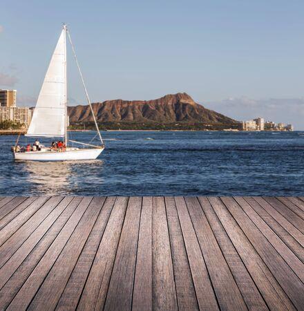 hawaii sunset: Wood plank or walk way with diamond head mountain background Hawaii Stock Photo