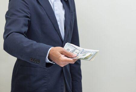 Businessman hand grabbing US dollar banknote, USD