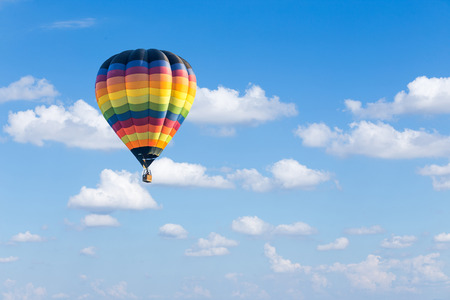 hot air balloons: Colorful hot air balloon on blue sky background