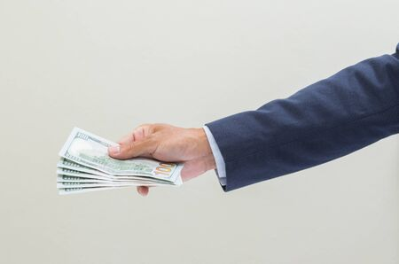 grabbing: Businessman hand grabbing US dollar banknote, USD